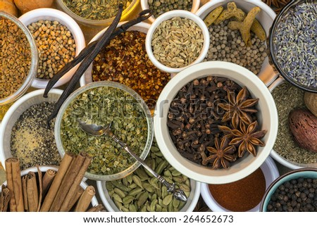 A selection of dried herbs and spices. Use in cooking to add seasoning and flavor to a meal. - stock photo