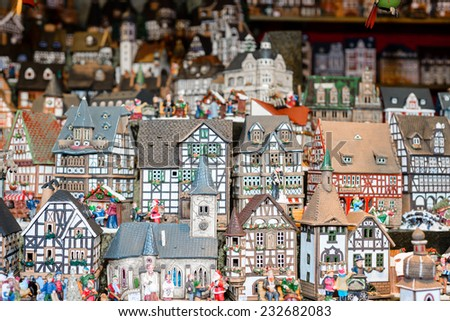 A selection of miniature buildings available for sale at a local christmas market - stock photo