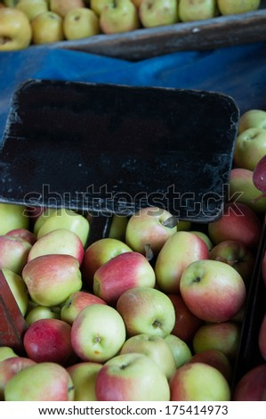 A selection of organic pink apples with a board for copy to be entered - stock photo