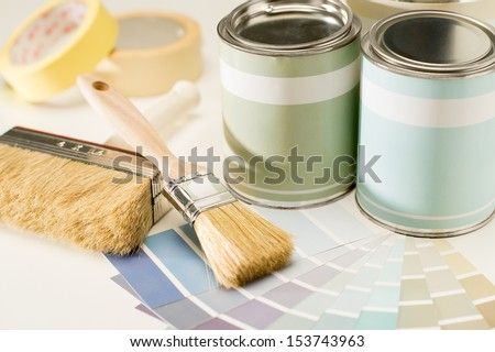 A selection of painting supplies swatch, brush and can - stock photo