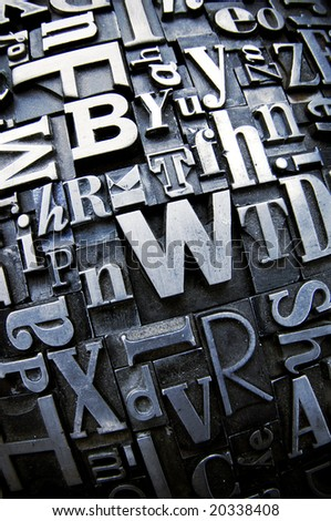 A selection of random letterpress type characters photographed with a fisheye lens. - stock photo