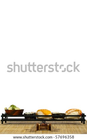 A selection of tasty salmon and rice sushi pieces with plenty of space to print your sushi menu on. - stock photo