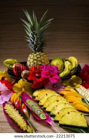 A selection of tropical fruits from Hawaii, including pineapple,kiwi,papaya,banana, mango,and starfruit - stock photo