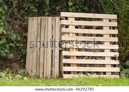 A self-made compost in the garden - stock photo