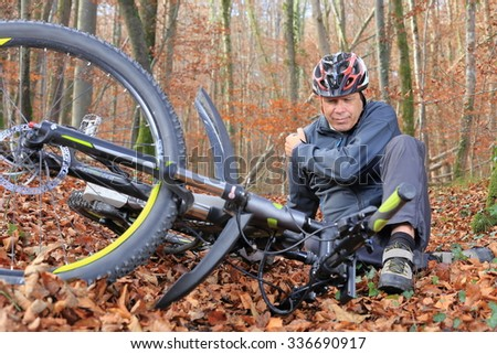 A Senior after bicycle accident with shoulder injury - stock photo
