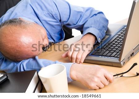 A senior asian businessman sleeping at his office - stock photo