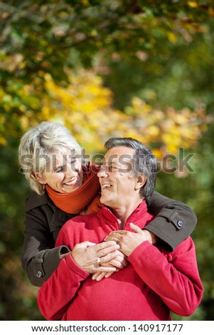 A senior couple enjoying the moment of love in a park - stock photo