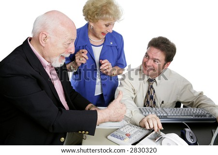 A senior couple giving their accountant thumbs-up for doing a great job on their taxes.  Isolated on white.  Focus is on the senior man. - stock photo