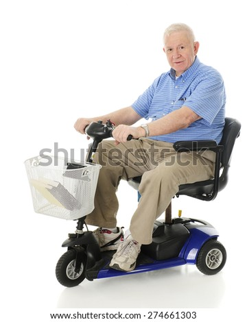A senior man smiling at the viewer as he's ready to drive away on his scooter.  On a white background - stock photo