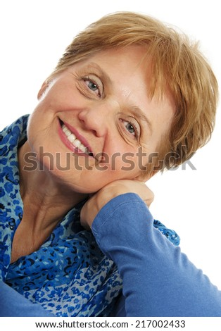 a senior woman - over sixty years old on white background - stock photo