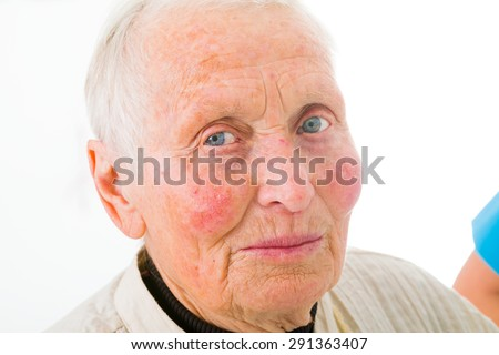 A senior woman photographed on wide angle, similar phone photograph. - stock photo