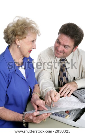 A senior woman seeking help with her taxes from an accountant.  Isolated on white. - stock photo