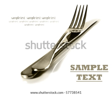 a Sepia image of a Knife and fork stacked up on a pure white background with space for text - stock photo