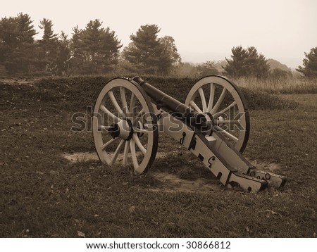 A sepia toned photo of a historic revolutionary war cannon on display at Valley Forge National Historic Park. - stock photo
