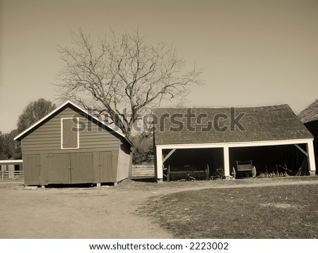 A sepia toned photograph of an old barn and shed at the historic  Longstreet Farm in Holmdel, New Jersey. - stock photo