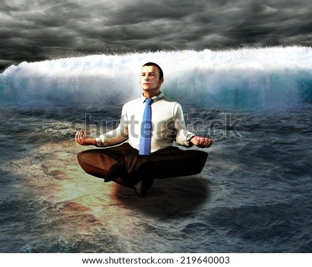 A serene businessman. The calm before the storm. - stock photo