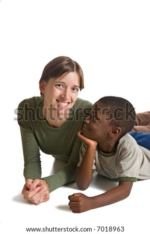 A series of images showing a young African American boy with a Caucasian woman. Isolated on white. - stock photo