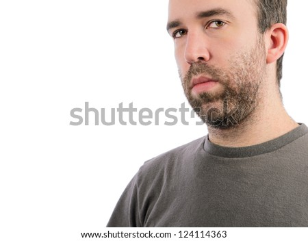 A serious man with a beard, isolated on a white background. - stock photo