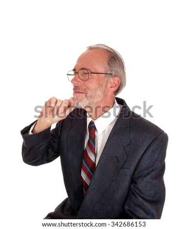 A serious portrait image of a middle age man in an suit and with glasseswith one hand on his chin, isolated for white background. - stock photo