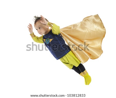 A serious preschool superhero, hands forward, cape blowing as he flies through space to perform a rescue.  On a white background. - stock photo