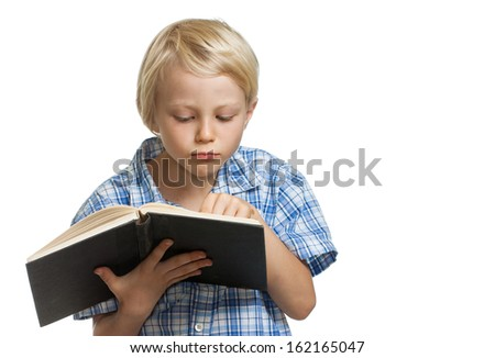 A serious young boy holding and reading a book. Isolated on white. - stock photo