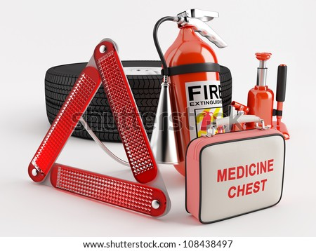 A set consisting of a wheel, fire extinguisher, first aid kit, warning triangle and jack - stock photo