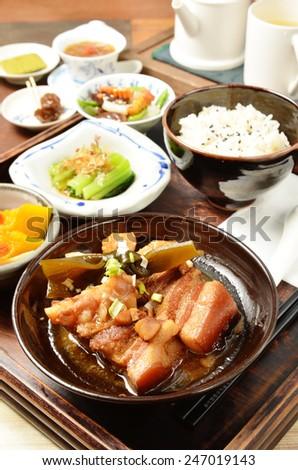 A set menu  stew pork with salad rice and soup .  - stock photo