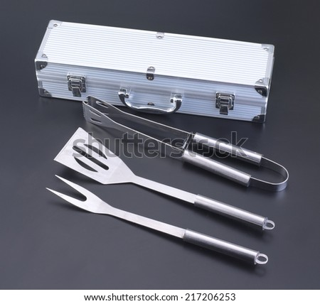 A set of BBQ tools in black background   - stock photo