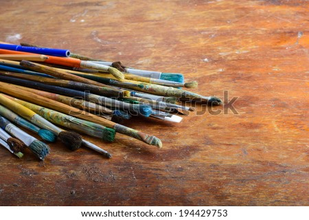 A set of brushes on wooden table  - stock photo