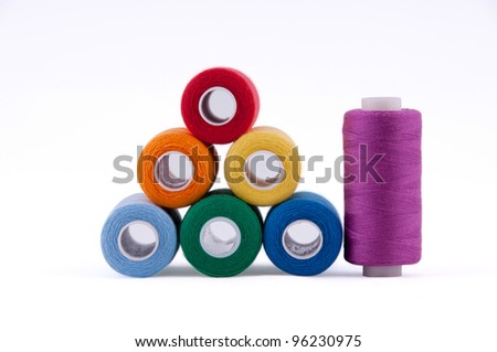 A set of coils on a white background. All the colors of the rainbow. - stock photo