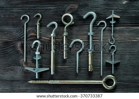 A set of fasteners. Ceiling hooks. - stock photo