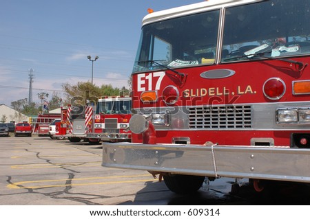 A set of fire trucks lined up in a parking lot after Katrina. Taken in Slidell, LA - stock photo