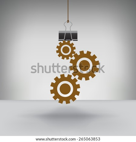 A Set of Gears Hung by a Binder Clip - stock photo