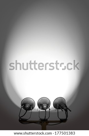 A set of halogen spotlight strobes lighting up a blank wall with copyspace for text. - stock photo