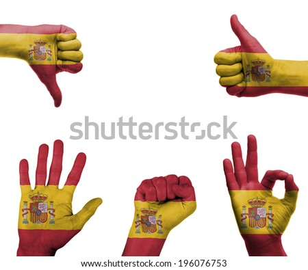 A set of hands with different gestures wrapped in the flag of Spain - stock photo