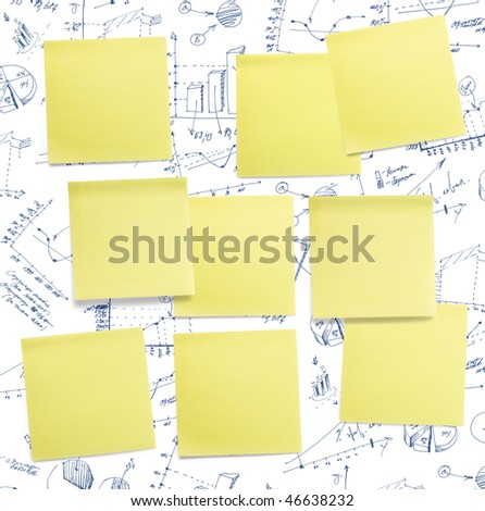 A set of office/work related yellow coloured paper post-it notes. - stock photo