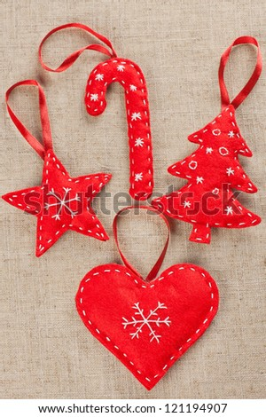A set of red felt handmade Xmas decorations - stock photo