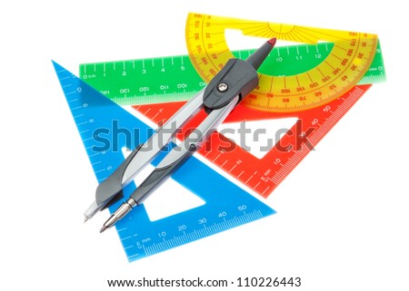 A set of rulers for the school and a compass on a white background. - stock photo
