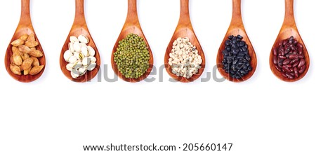 A set of seed in spoons isolated on white. - stock photo