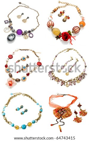 a set of six pairs of earrings with necklace isolated on white - stock photo
