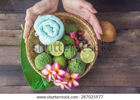 A set of Spa and thai massage with Kaffir Lime on wooden background - stock photo