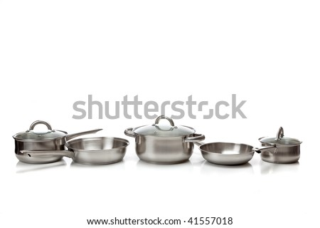 A set of stainless steel pots and pans - stock photo