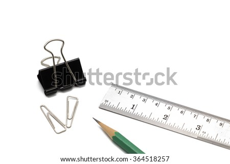 A set of stationery including wire paper clips, a black paperclip a green pencil and a metallic ruler on white background as designing concept - stock photo