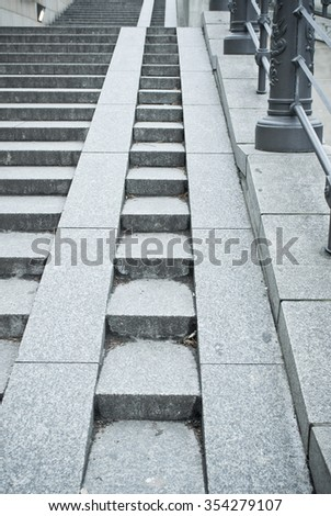 A set of stone steps in Germany with a ramp for wheelchairs and pushchairs - stock photo