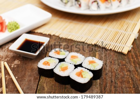 A set of sushi on a wooden surface - stock photo