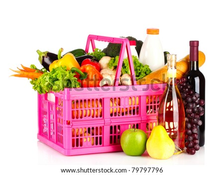 A set of vegetables in plastic basket isolated on white - stock photo