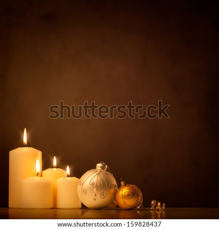 A set of white candles and Christmas ornaments reflecting the tranquility and holiness of winter holidays. - stock photo