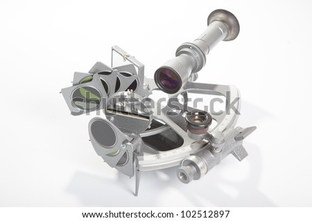 A sextant is an instrument used to measure the angle between any two visible objects. - stock photo