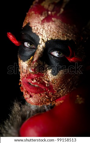 A sexy girl dressed up as a fantasy fire demon - stock photo