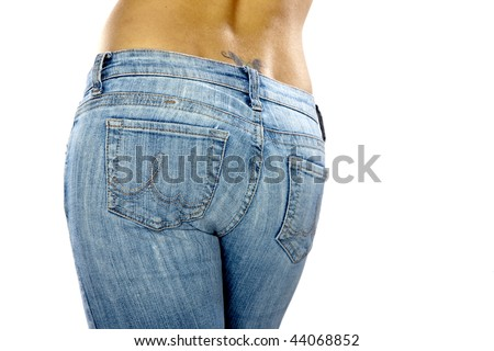 A sexy model wearing a pair of blue jeans against a white background - stock photo